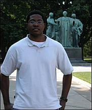 2006 student Chukwuma Nweke from Georgia Tech beside the U of I Alma Mater.